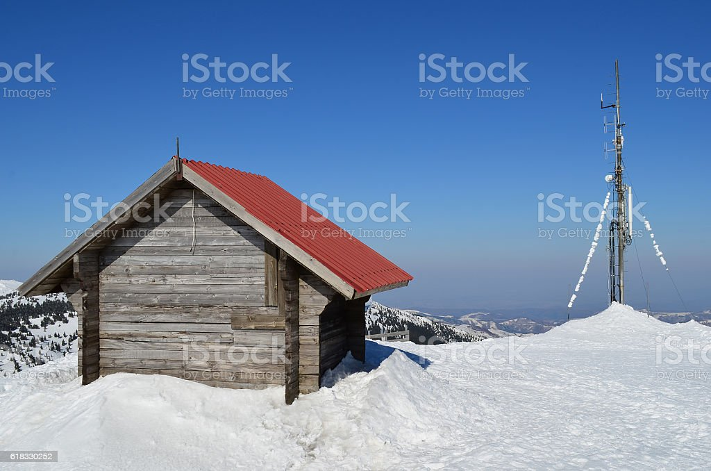 Sheller and antenna in melting snow stock photo