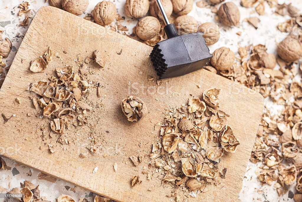 Shelling walnuts in the kitchen royalty-free stock photo