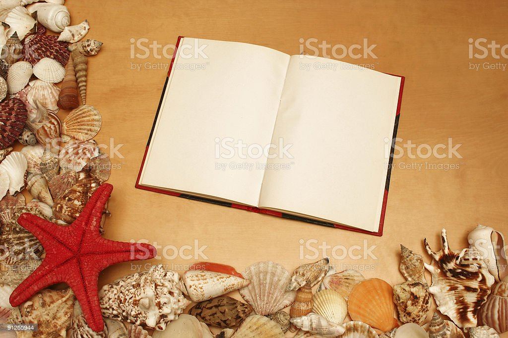 Shells and blank notebook royalty-free stock photo
