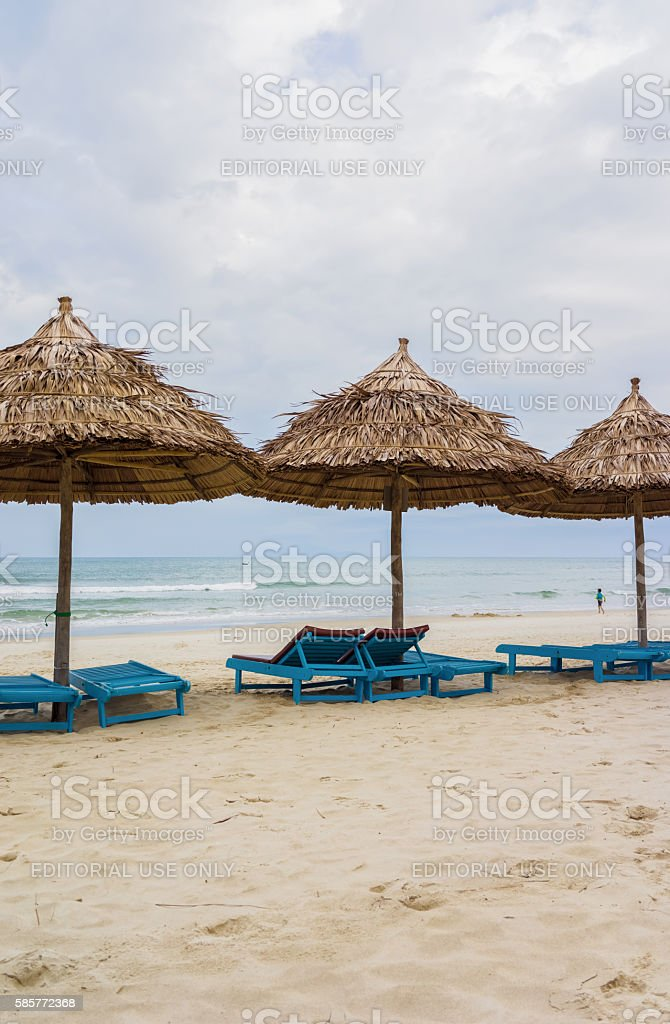Shelter and sunbeds in China Beach in Da Nang stock photo