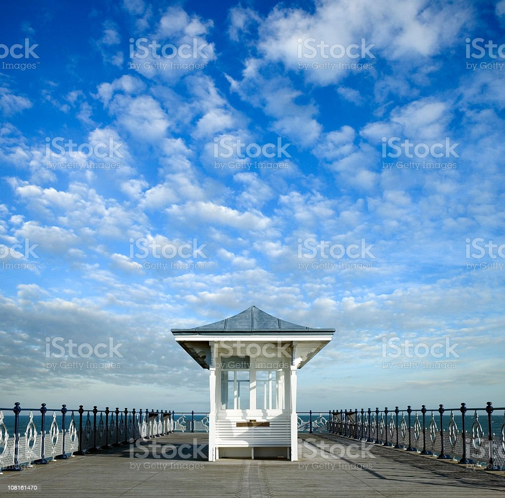 Shelter on End of Ocean Pier During Sunny Day stock photo