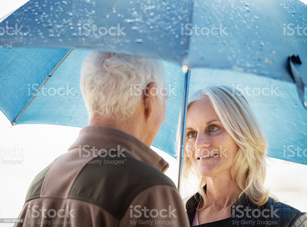 Sheltering together from the rain stock photo