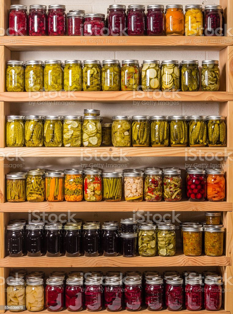 Shelves of canned goods stock photo