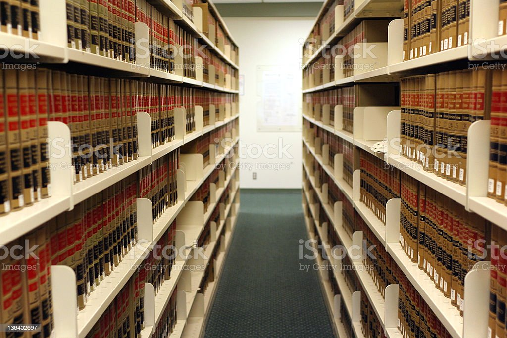 Shelves of legal digests in law library stock photo