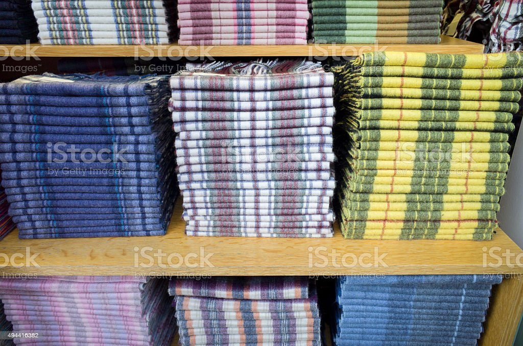 Shelves of Traditional Scottish Tartan Lambswool Scarves For Sale stock photo