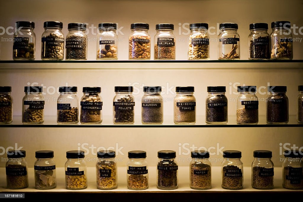 Shelves with labeled jars of exotic spices stock photo