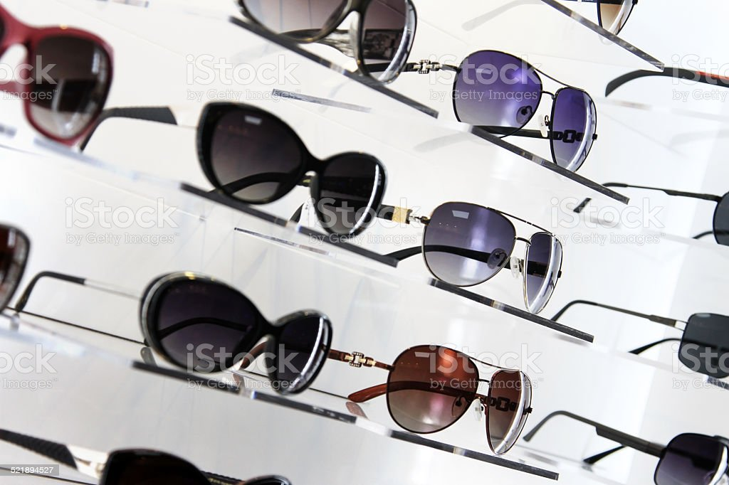 shelves with sunglasses stock photo
