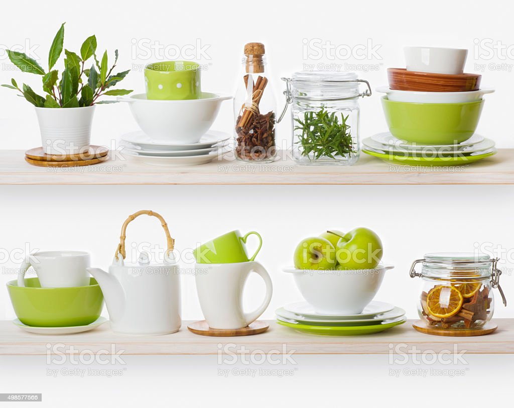 Shelves with various food ingredients and kitchen utensils stock photo