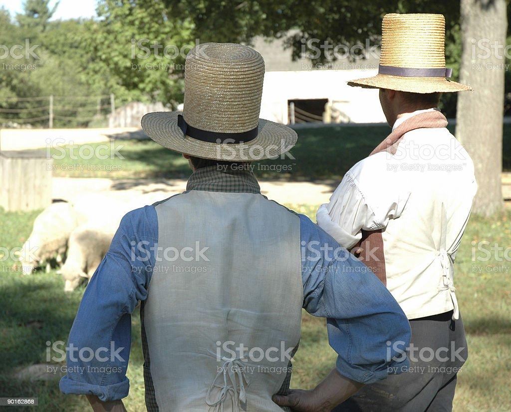 Shepards watching their sheep stock photo