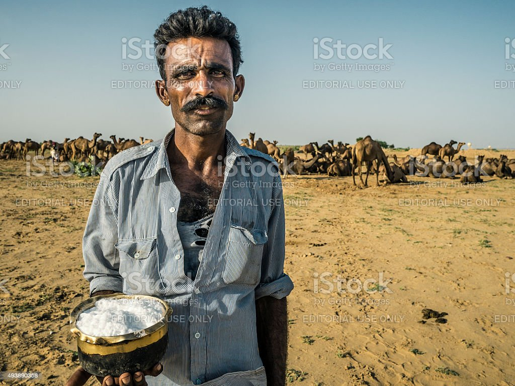 Shepherd with camel milk Thar desert Rajasthan India stock photo