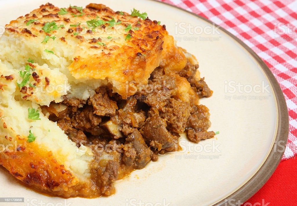 Shepherd's Pie on a ceramic plate, garnished with parsley stock photo