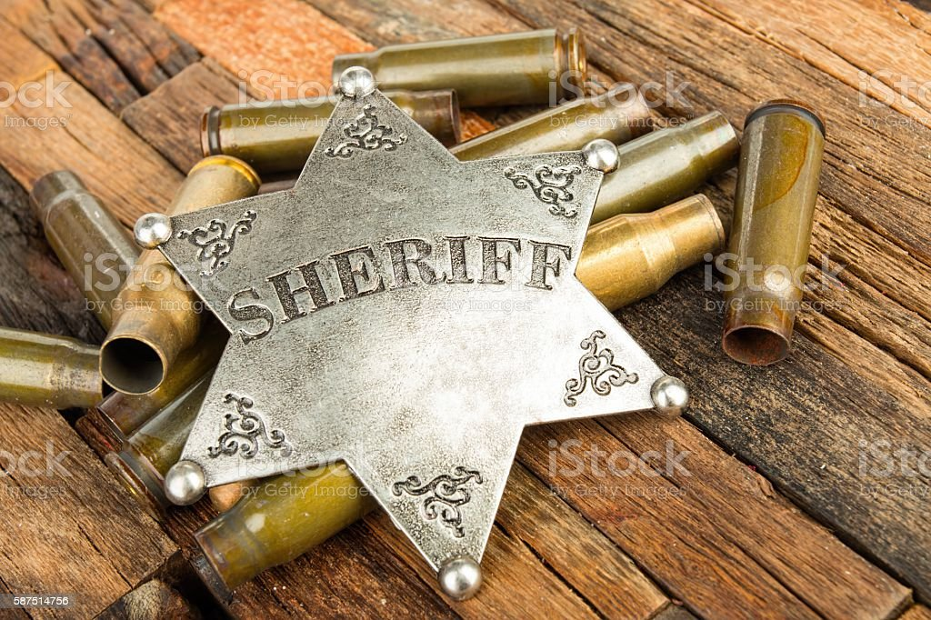 Sheriff badge and bullets shell stock photo