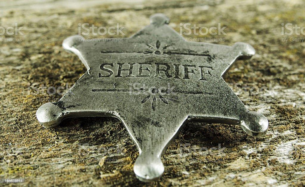 Sheriff Badge on Barn Board royalty-free stock photo