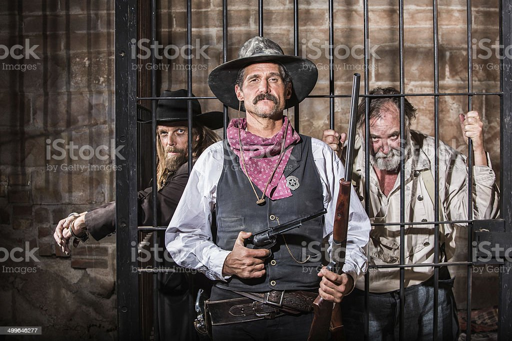 Sheriff Poses With Prisoner stock photo