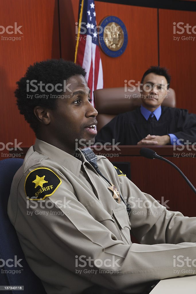 Sheriff Testifies for Judge in Courtroom stock photo