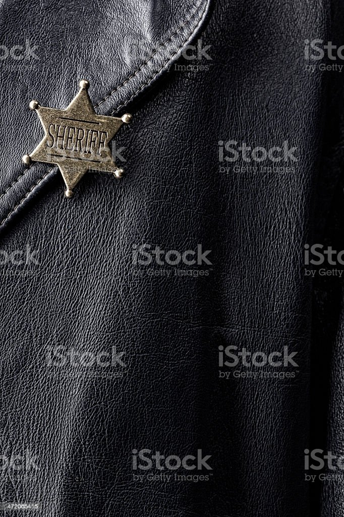Sheriff's Badge On A Leather Coat royalty-free stock photo