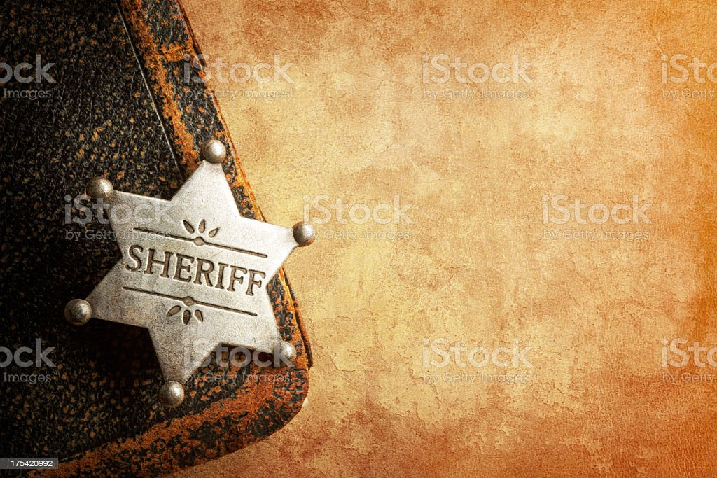 Sheriff's badge on warm textured surface stock photo