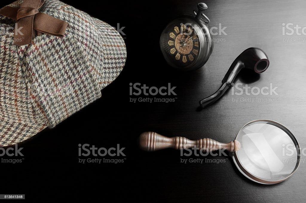 Sherlock Deerstalker Hat,  Clock, Magnifier And Smoking Pipe In stock photo