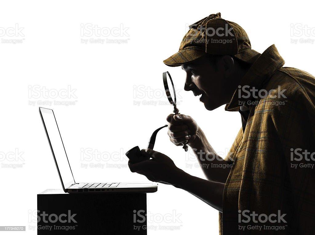 Sherlock Holmes using a laptop royalty-free stock photo