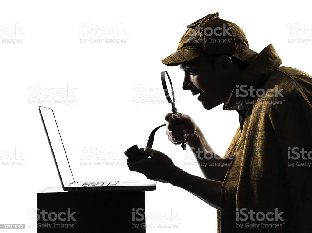 Sherlock Holmes using a laptop stock photo