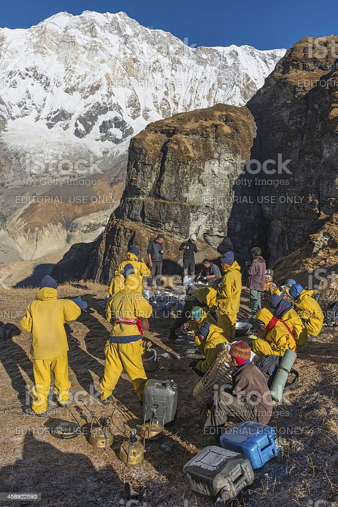 Sherpa expedition porters below Annapurna Himalayas Nepal royalty-free stock photo