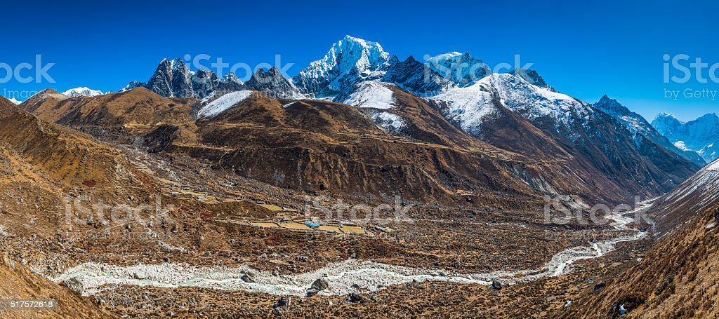 Sherpa farms high in remote Himalaya mountain peaks panorama Nepal stock photo