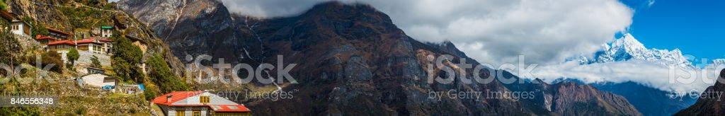 Sherpa monastery teahouses Buddhist prayer flags Himalaya mountains panorama Nepal stock photo