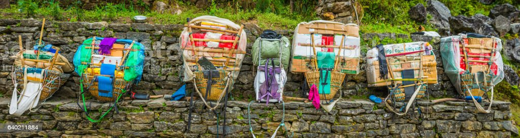 Sherpa porter bamboo doko baskets namlo head straps Himalayas Nepal stock photo