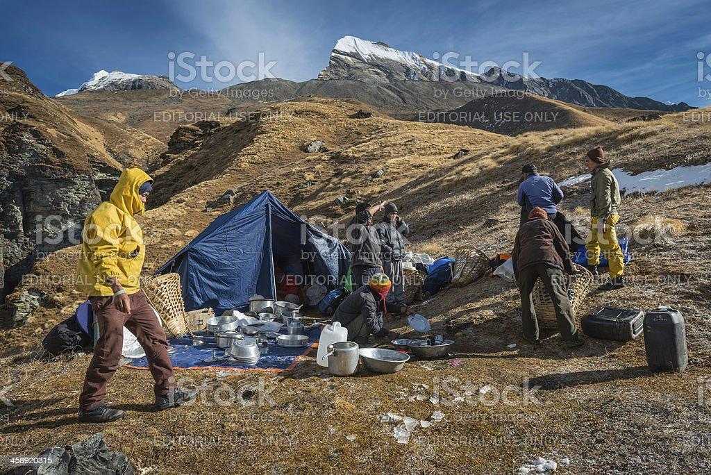 Sherpa porter expedition team at Himalaya base camp Nepal royalty-free stock photo