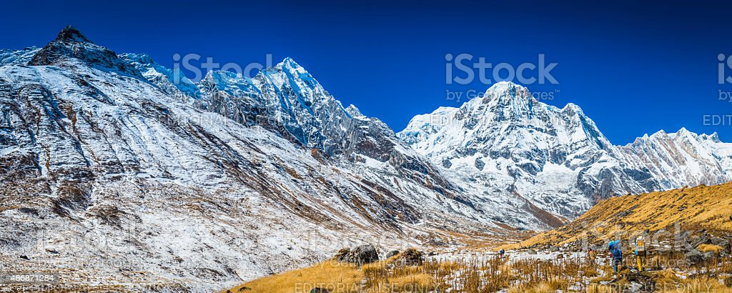 Sherpa porters carrying expedition kit Annapurna Base Camp Himalayas Nepal stock photo