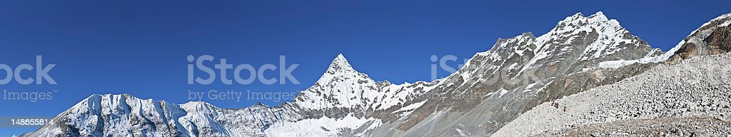 Sherpa porters hiking over Amphulapcha high altitude mountain pass Himalayas royalty-free stock photo