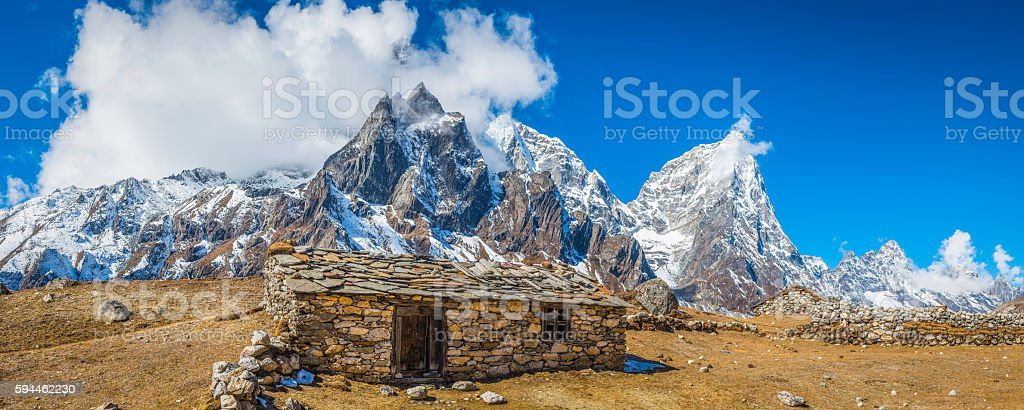Sherpa stone barn high in remote Himalaya mountain pasture Nepal stock photo