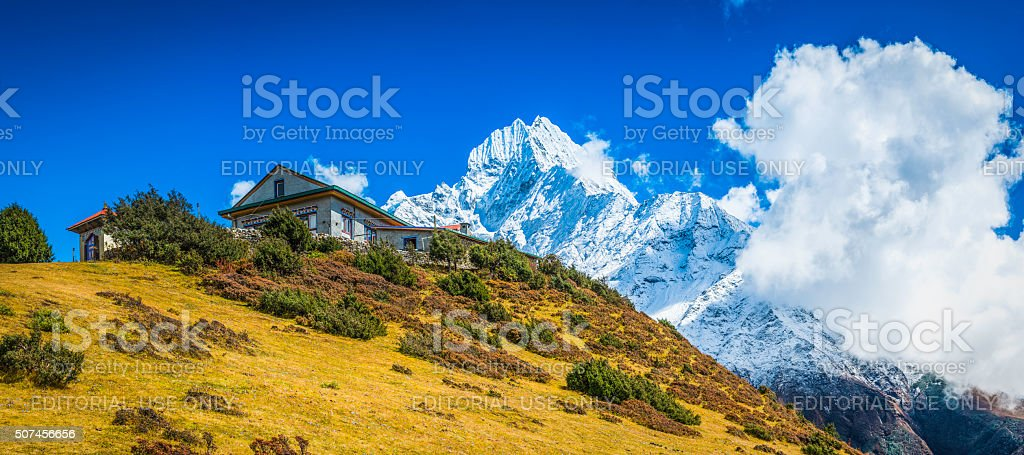 Sherpa teahouses overlooked by snowy mountain peaks Khumbu Himalaya Nepal stock photo