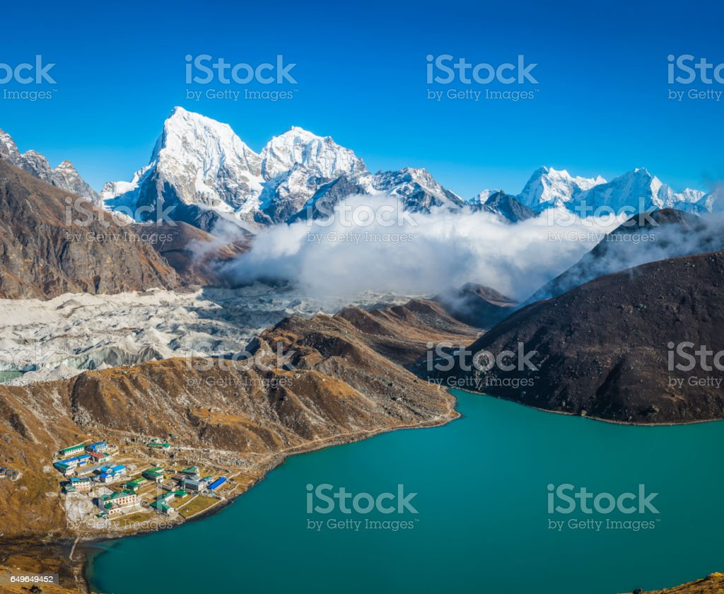 Sherpa village teahouses glaciers Himalayan mountain peaks Gokyo Nepal stock photo