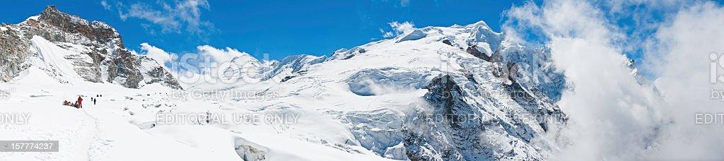 Sherpas and mountaineers climbing snow glacier peaks panorama Himalayas Nepal royalty-free stock photo