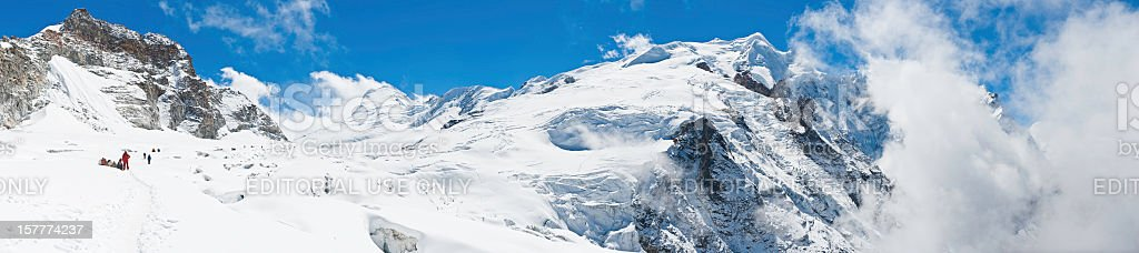 Sherpas and mountaineers climbing snow glacier peaks panorama Himalayas Nepal stock photo