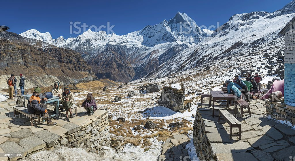 Sherpas and porters relaxing at Annapurna Base Camp Himalayas Nepal royalty-free stock photo