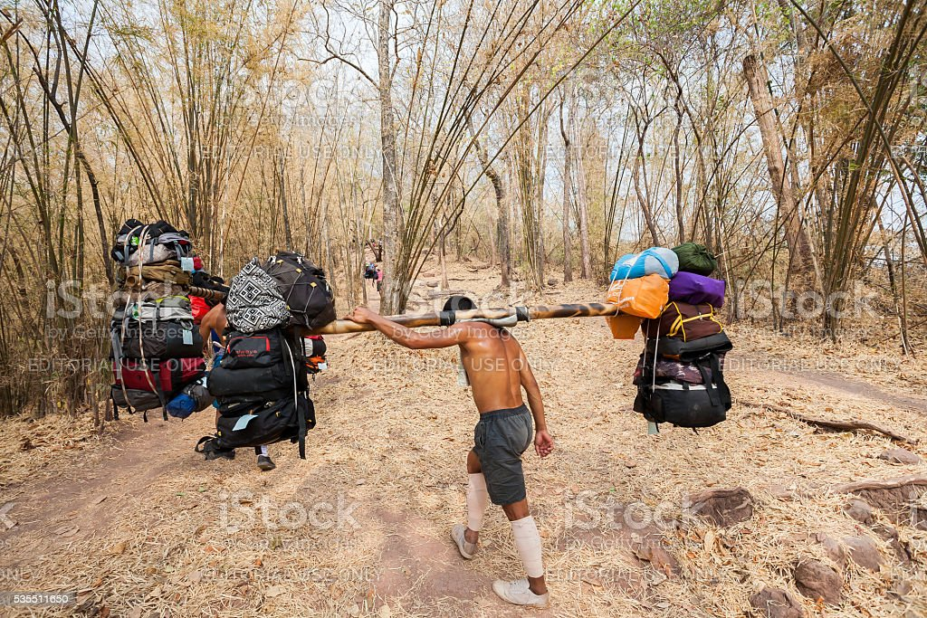 Sherpas are carrying a lot of baggage stock photo