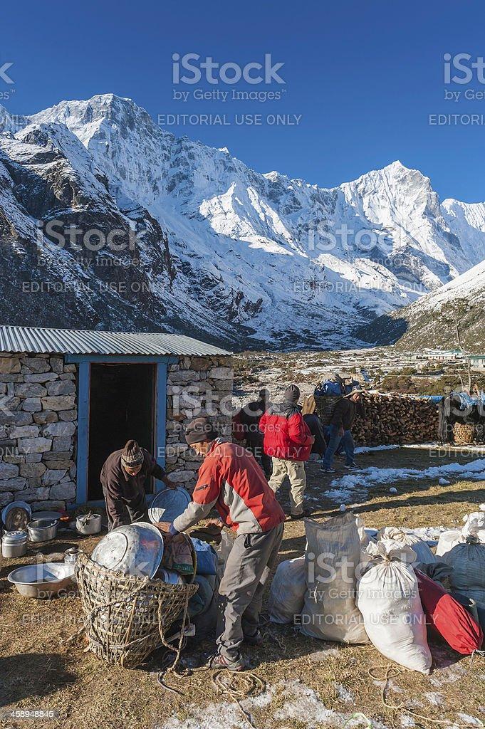 Sherpas breaking camp in Himalayas Nepal royalty-free stock photo