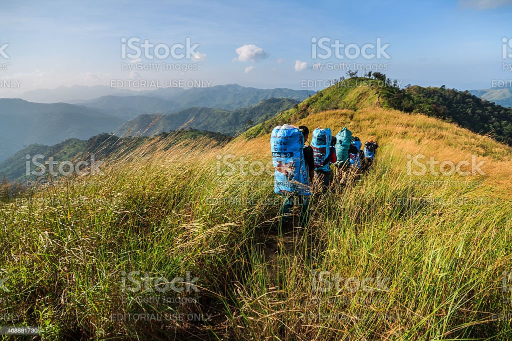 Sherpas walked up to the hill  through the prairie stock photo