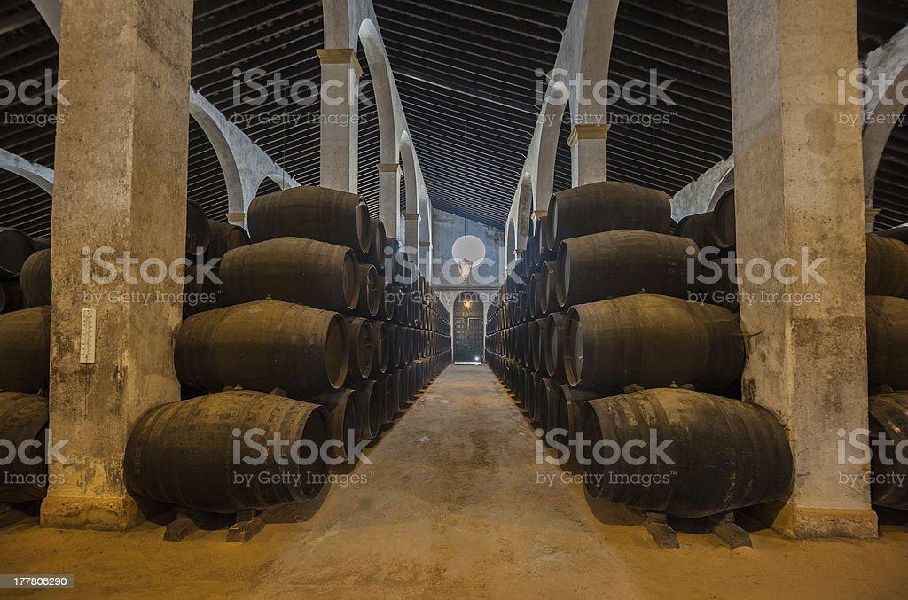 Sherry barrels line a walkway in a bodega in Jerez, Spain  stock photo