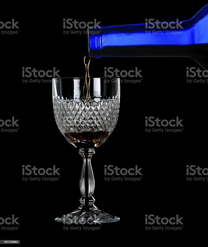 Sherry or port being poured into glass royalty-free stock photo