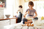 She's a great little helper in the kitchen