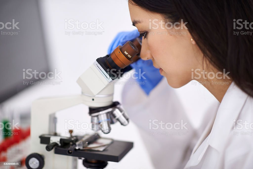 She's a professional at blood-work stock photo