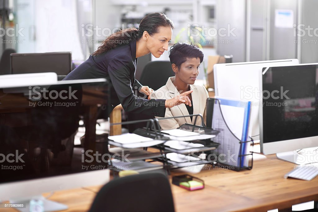 She's always available to assist her colleagues stock photo