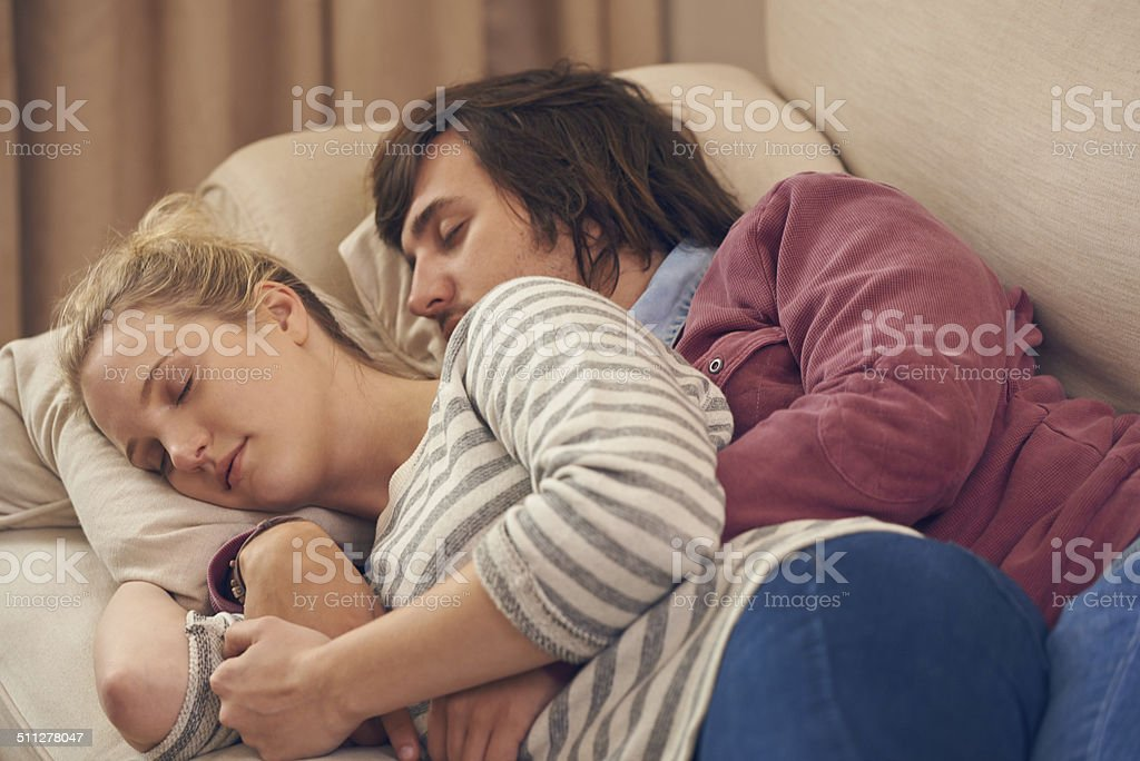 She's always comfortable in his arms stock photo