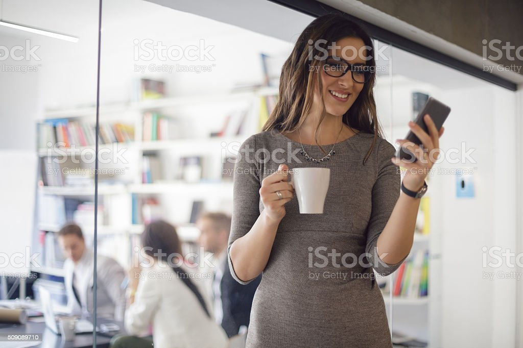 She's checking her text messages stock photo