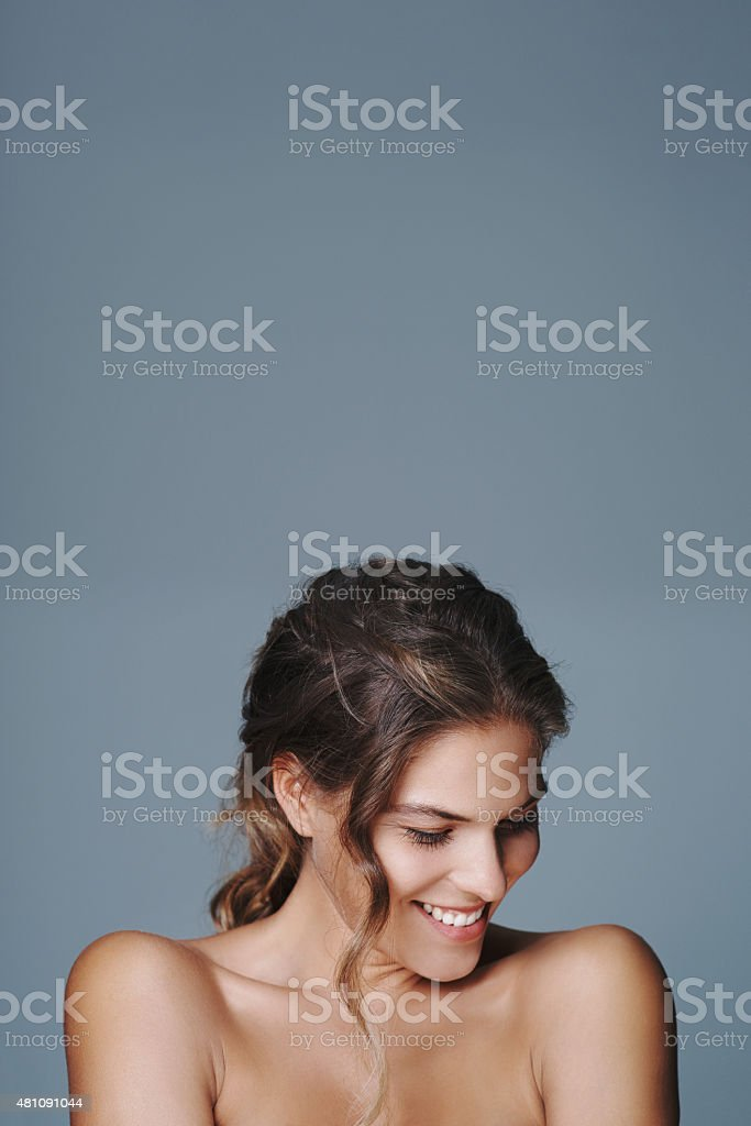 She's comfortable in her own skin stock photo