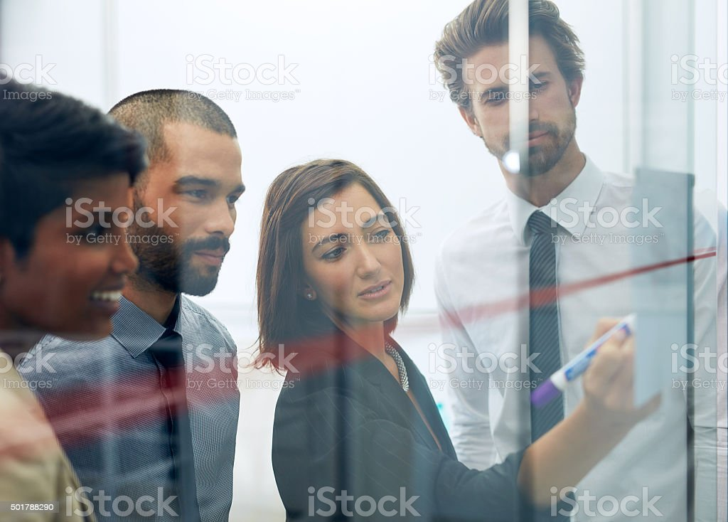 She's communicating her idea to the team stock photo