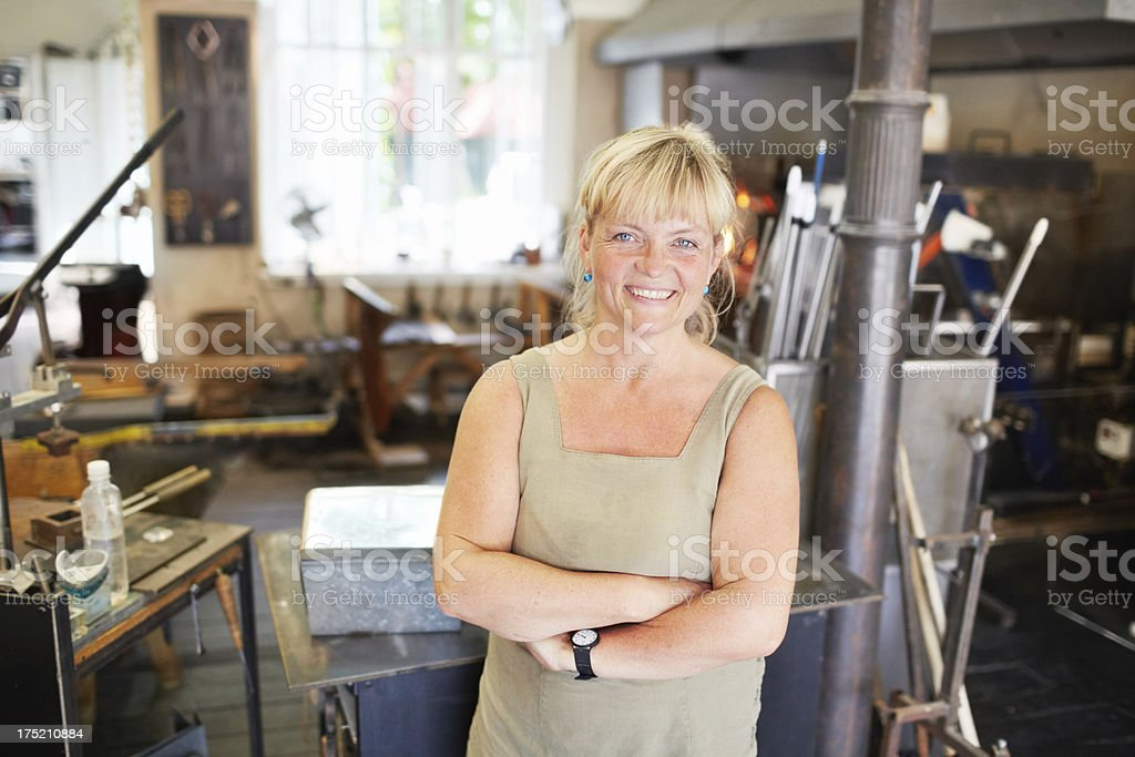 She's confident in her glassblowing skills stock photo